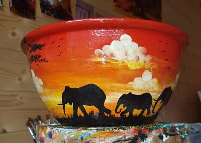 Hand painted pots with African animals and scenes