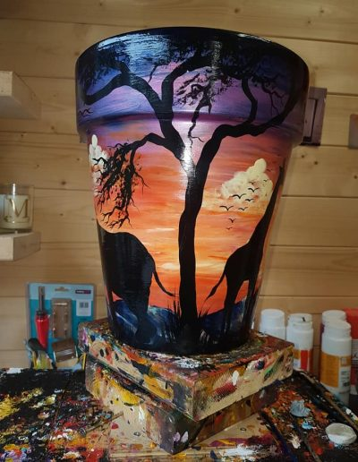 Hand painted flower pots with African animals and scenes