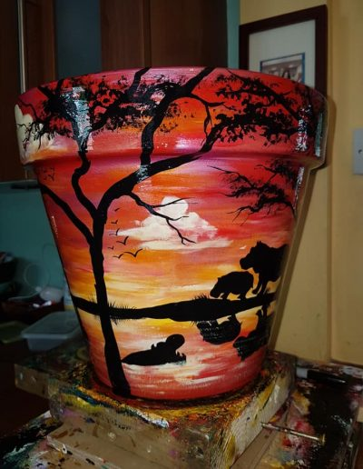 Hippo flower pot. Hand painted flower pots with African animals and scenes
