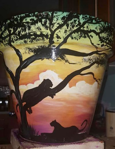 Leopard flower pot. Hand painted flower pots with African animals and scenes