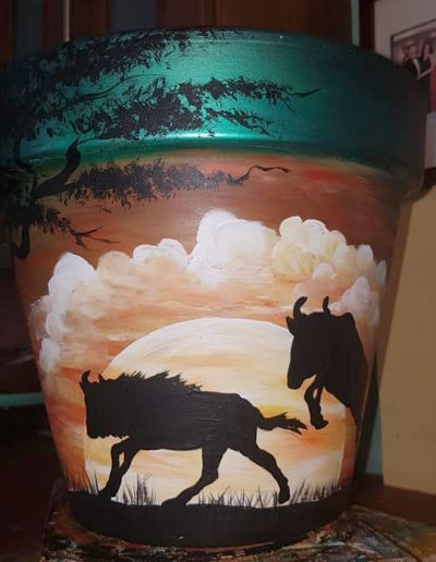 Wildebeest flower pot. Hand painted flower pots with African animals and scenes