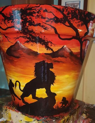 Lion flower pot. Hand painted flower pots with African animals and scenes