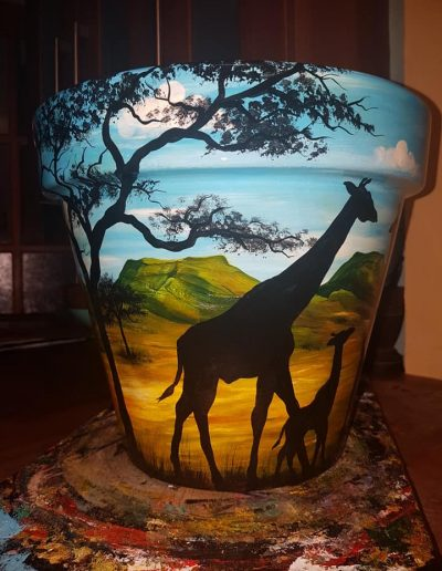 Giraffe flower pot. Hand painted flower pots with African animals and scenes